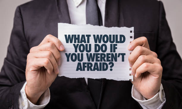 what would you do if you weren't afraid? - fear stock photos and pictures