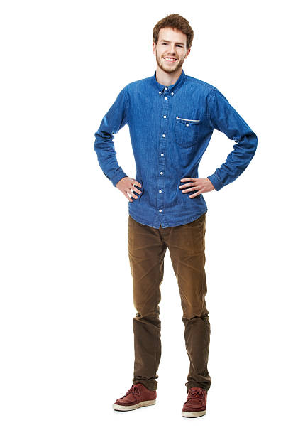 What you see is what you get A full length portrait of a happy young man isolated on white akimbo stock pictures, royalty-free photos & images