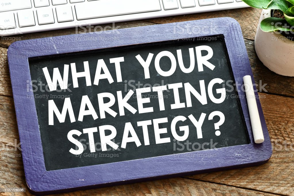 What your marketing strategy? text on a chalk board stock photo