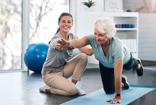Whatever your age it's important to workout Shot of a senior woman being treated by a physiotherapist recovery stock pictures, royalty-free photos & images