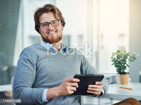 874813790 istock photo What's a modern office without modern technology 1140571058