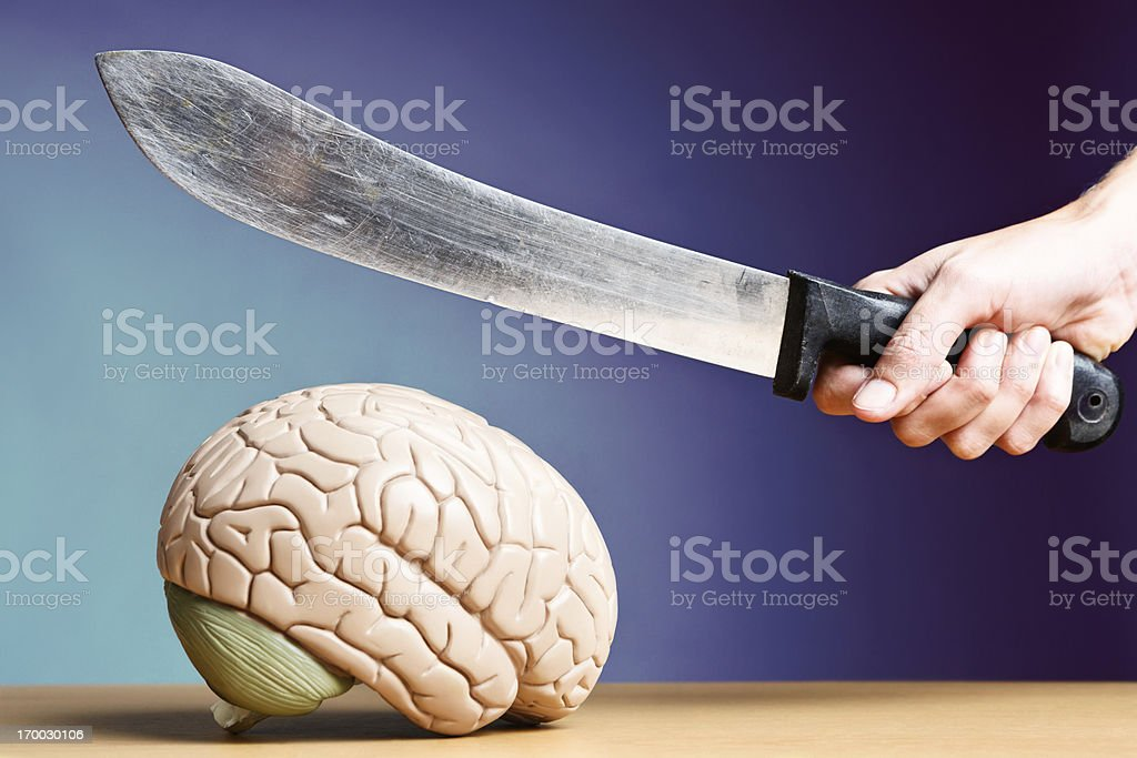 What's happening inside your head? Knife approaching model brain royalty-free stock photo