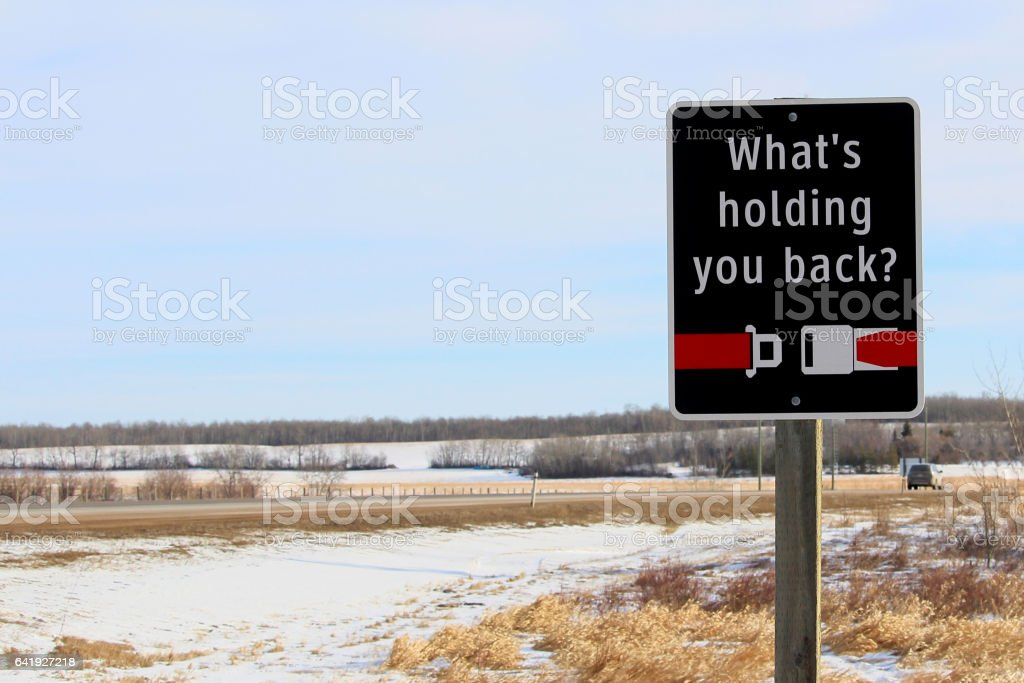 What's Holding You Back Seat Belt Reminder Sign stock photo