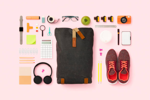 What's in my backpack flat lay School supplies and backpack flat lay. Back to school flat lay on pink background knolling concept stock pictures, royalty-free photos & images