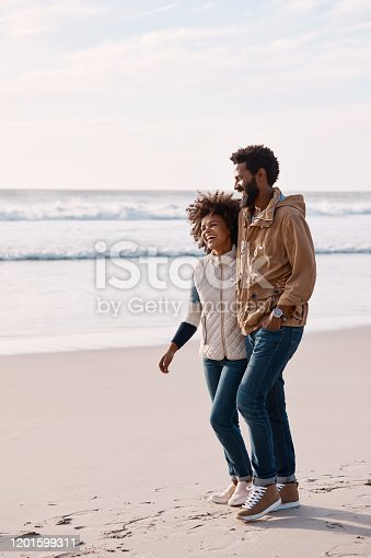 1094338222 istock photo What's more romantic than a walk along the beach? 1201599311