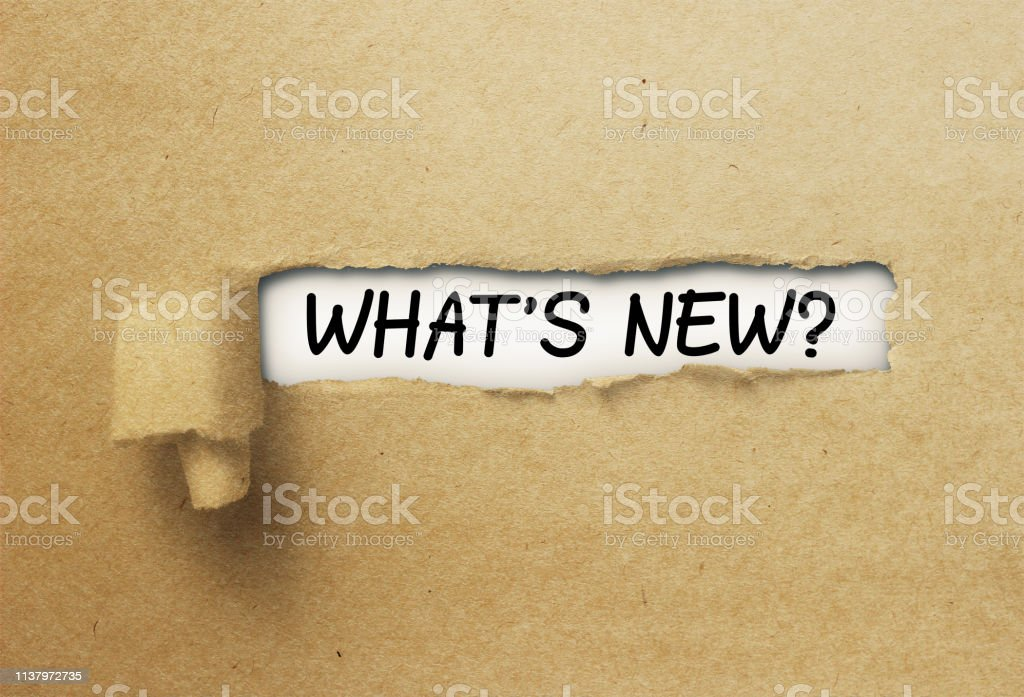 What's new behind ripped curl paper stock photo