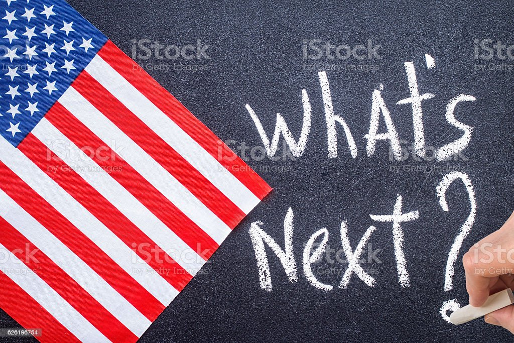 What's next on the chalk board and US flag stock photo