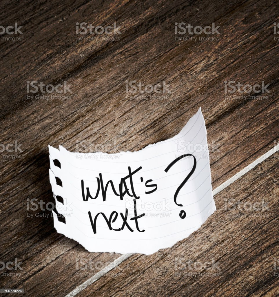What's Next written on notepad stock photo