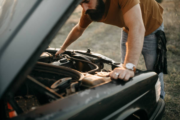 What's now?! Photo of young man is fixing his car vehicle hood stock pictures, royalty-free photos & images
