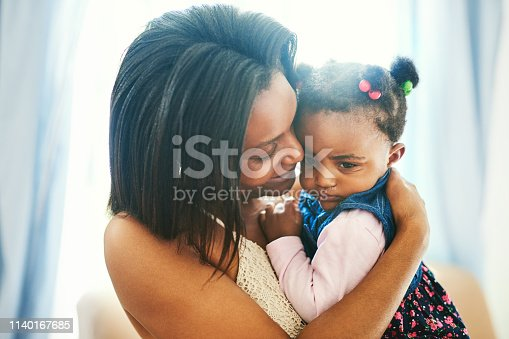 Shot of a mother bonding with her little daughter daughter at home