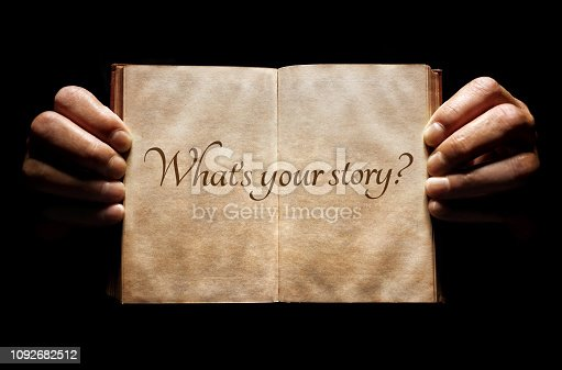 istock What's your story? hands holding an open book background 1092682512