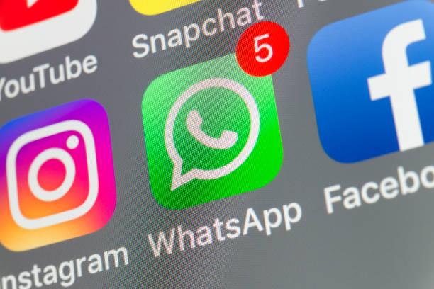 whatsapp, facebook, instagram and other cellphone apps on iphone screen - instagram стоковые фото и изображения