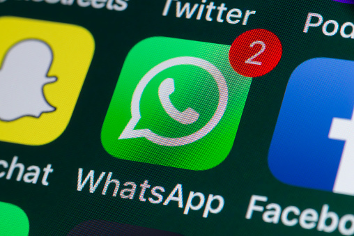 London, UK - July 31, 2018: The buttons of WhatsApp, Facebook, Twitter and other apps on the screen of an iPhone.