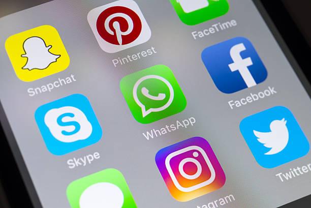 whatsapp, skype, facebook and social media apps on cellphone - skype imagens e fotografias de stock