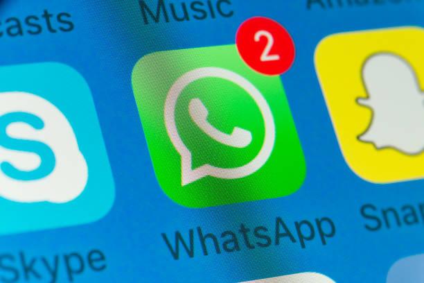 whatsapp, snapchat, skype and other cellphone apps on iphone screen - skype imagens e fotografias de stock