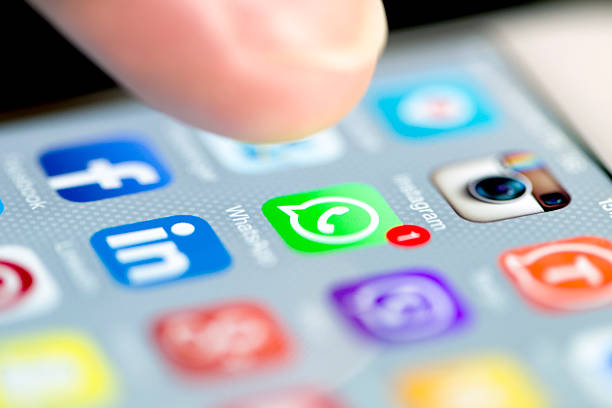 Whatsapp with One Notification While a Finger Taps to Open Istanbul, Turkey - September 18, 2015: Apple Iphone 6 screen with social media applications of Whatsapp, Facebook, Instagram, Viber, Linkedin, Tango, Perisfind and Snapchat while a male finger is about to touch on Whatsapp app. editorial stock pictures, royalty-free photos & images