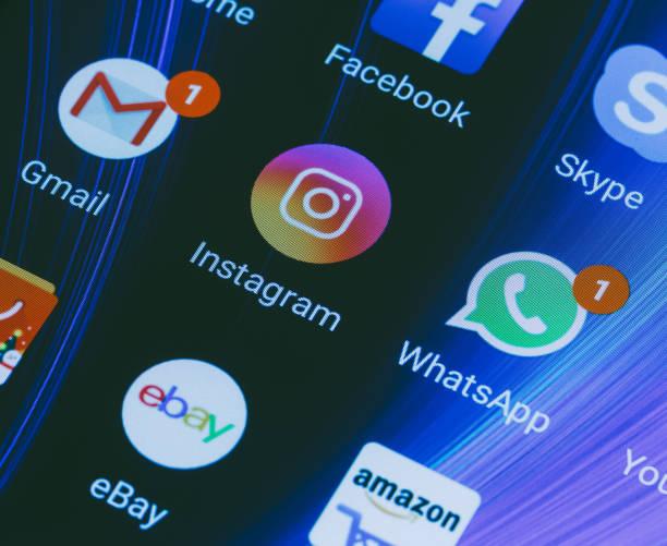 whatsapp, youtube, instagram, facebook, skype and other app icons on the smartphone screen xiaomi - instagram стоковые фото и изображения