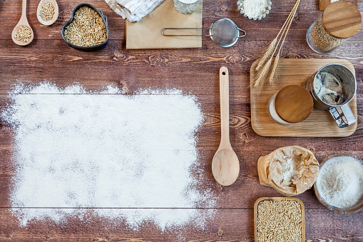 istock wheat and flour on rustic wooden table, top view, copy space 837140540