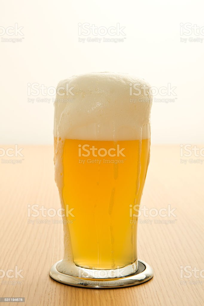 wheat beer in a glass stock photo