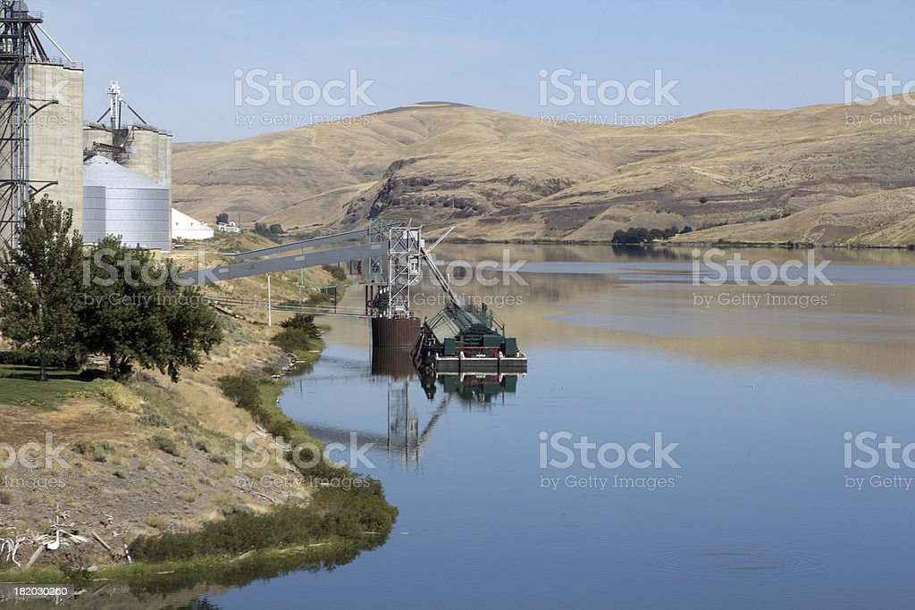 Wheat being loaded on barge stock photo