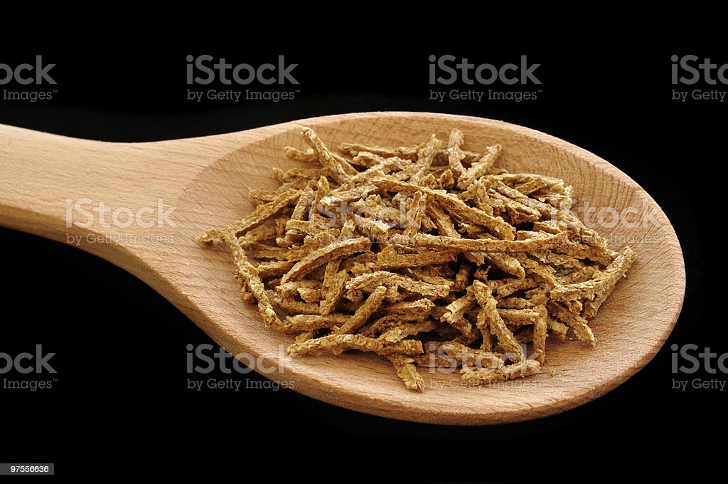 Wheat Bran Cereal on Wooden Spoon royalty-free stock photo