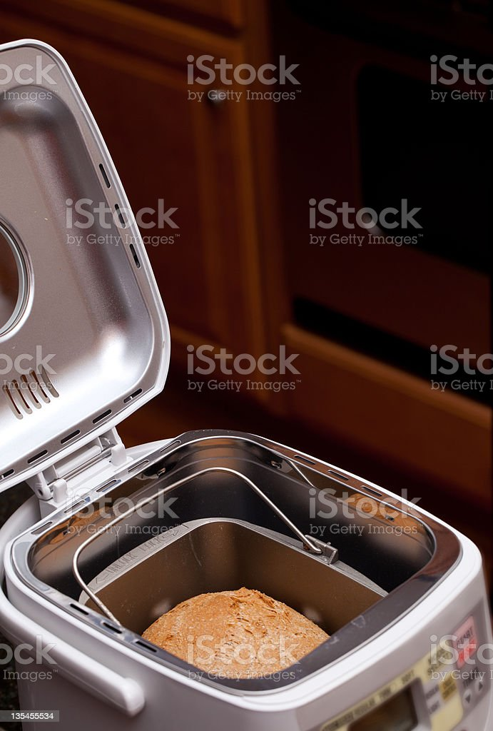 Wheat bread baked in machine stock photo
