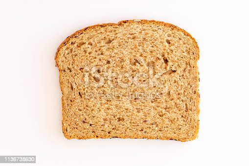 Healthy wheat bread with seeds and nuts on a white background