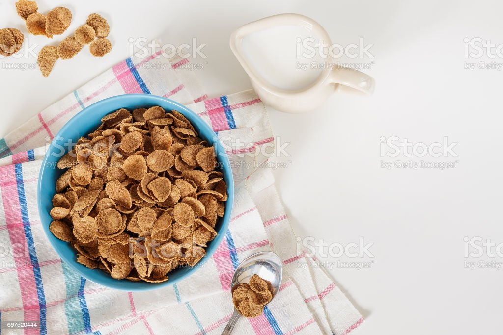 Wheat buckwheat bran breakfast cereal with milk in ceramic bowl stock photo