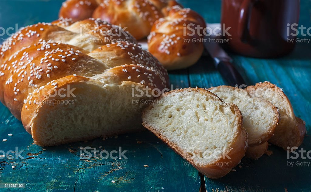 wheat buns with sesame seeds on a dark wooden background stock photo