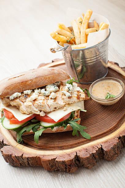 Wheat chicken sandwich burger, fried potatoes, mustard sauce stock photo