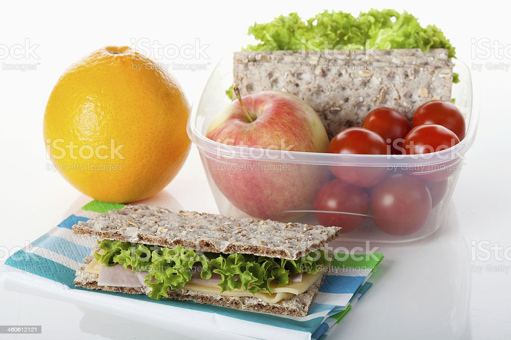 Wheat crackers, orange, apple, lettuce, cheese and tomatoes royalty-free stock photo