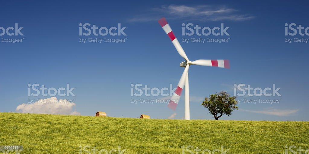 Wheat field and wind turbine royalty-free stock photo