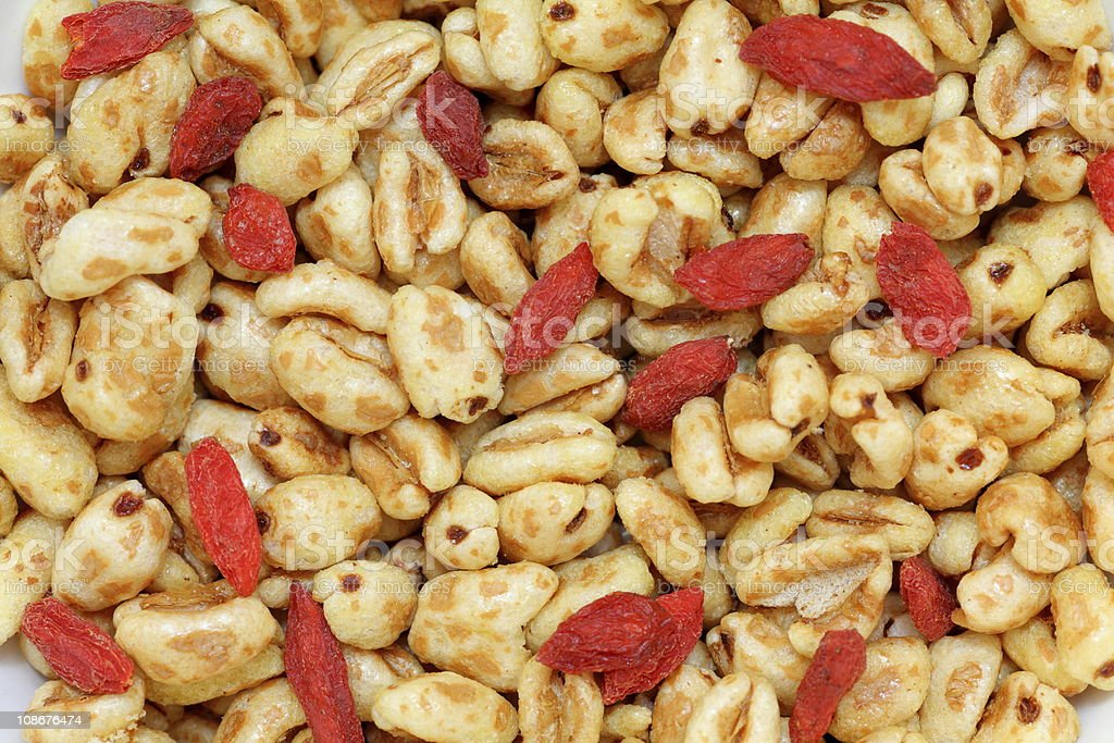 Wheat flakes with wolfberries royalty-free stock photo