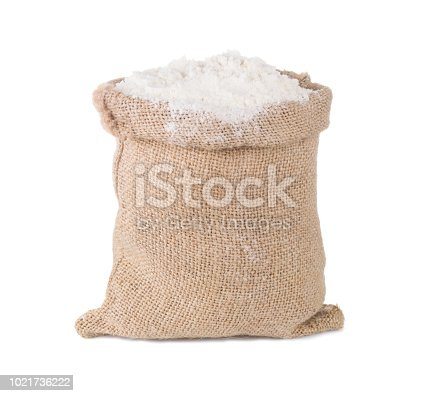 flour in burlap sack bag isolated on white background