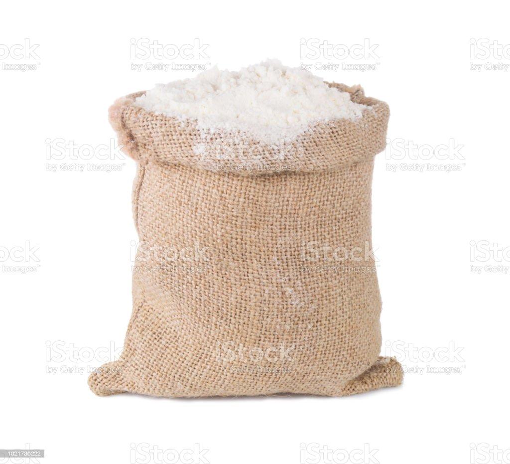 Wheat flour in burlap sack bag isolated on white background stock photo