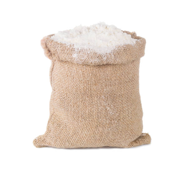 Wheat flour in burlap sack bag isolated on white background stock photo