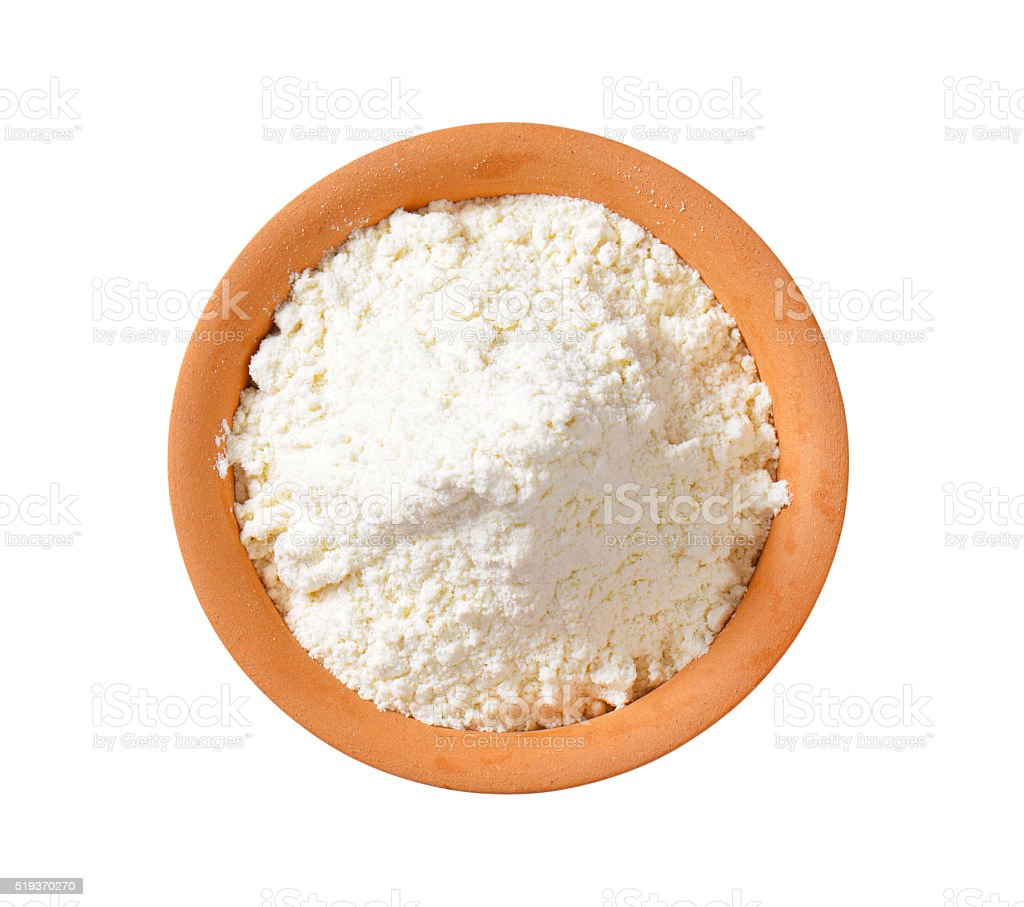Wheat flour in terracotta dish stock photo