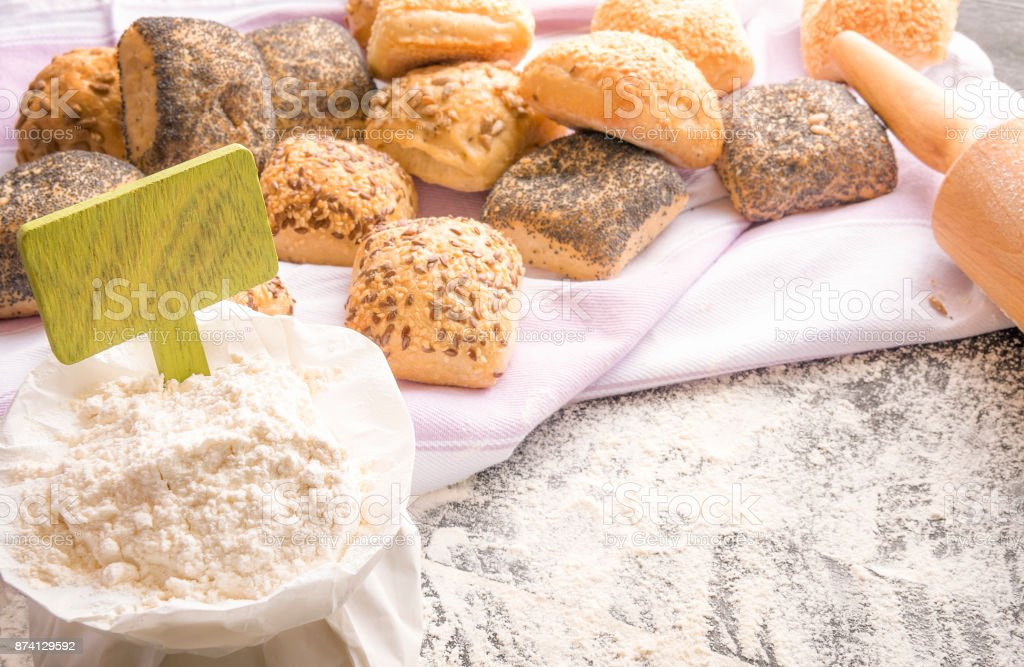 Wheat flour with banner and bread stock photo