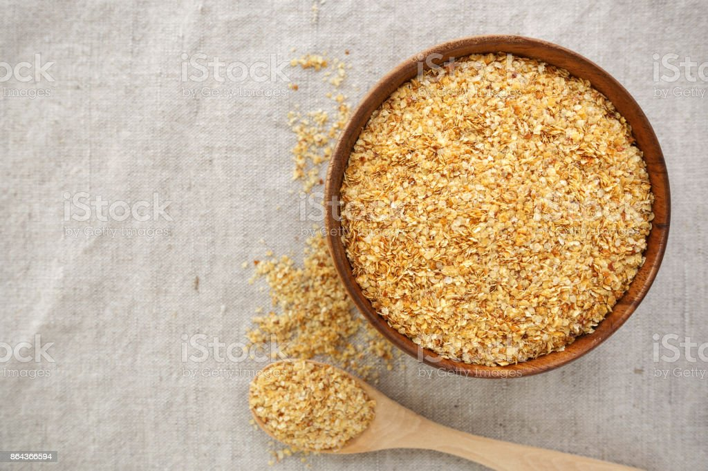 Wheat germ in bowl background stock photo