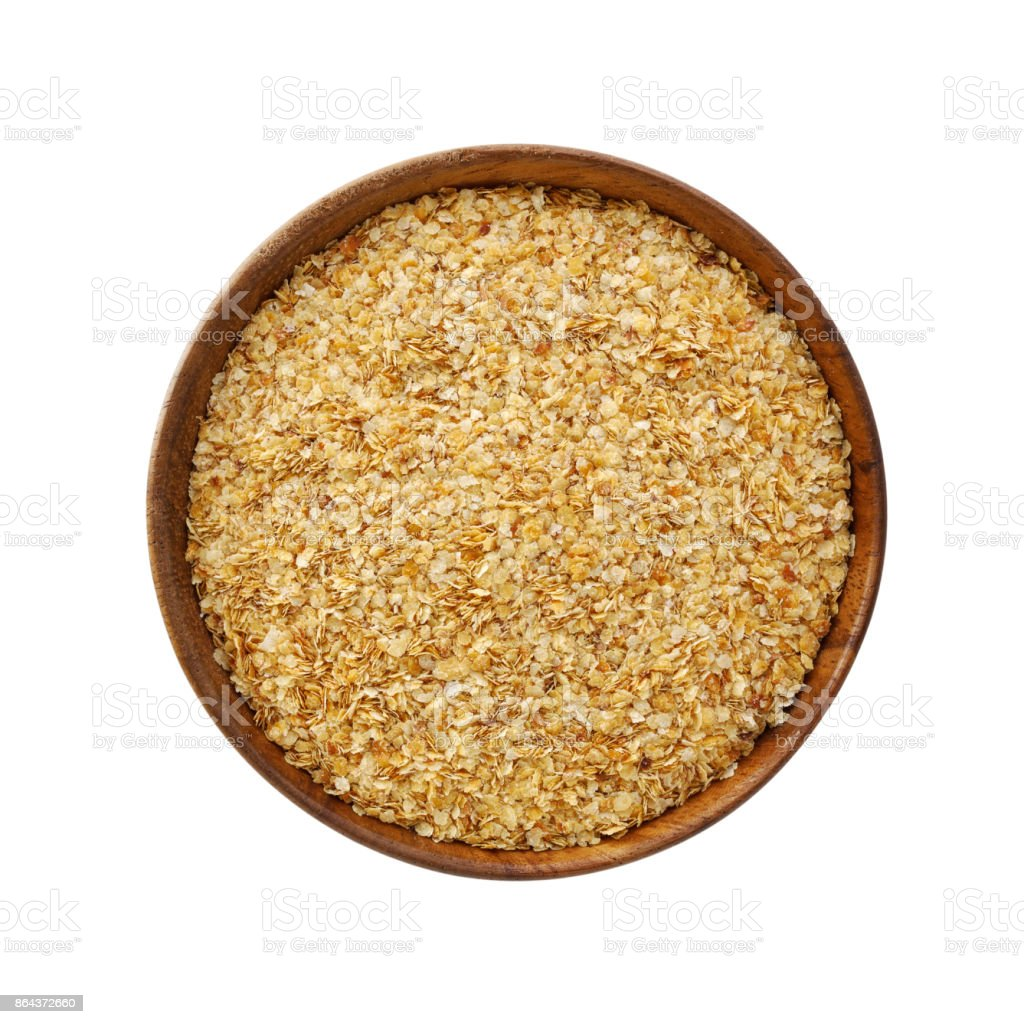 Wheat germ in bowl isolated on white stock photo