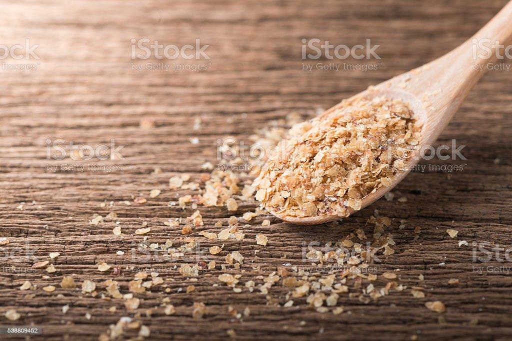 Wheat germ on wood spoon stock photo
