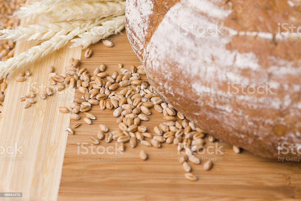 Wheat grains and bread royalty-free stock photo