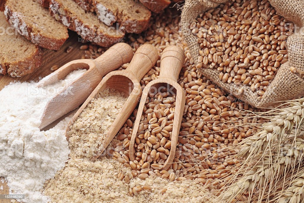 Wheat grains, bran and flour stock photo
