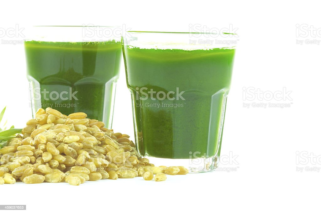 Wheat grass juice on white background royalty-free stock photo