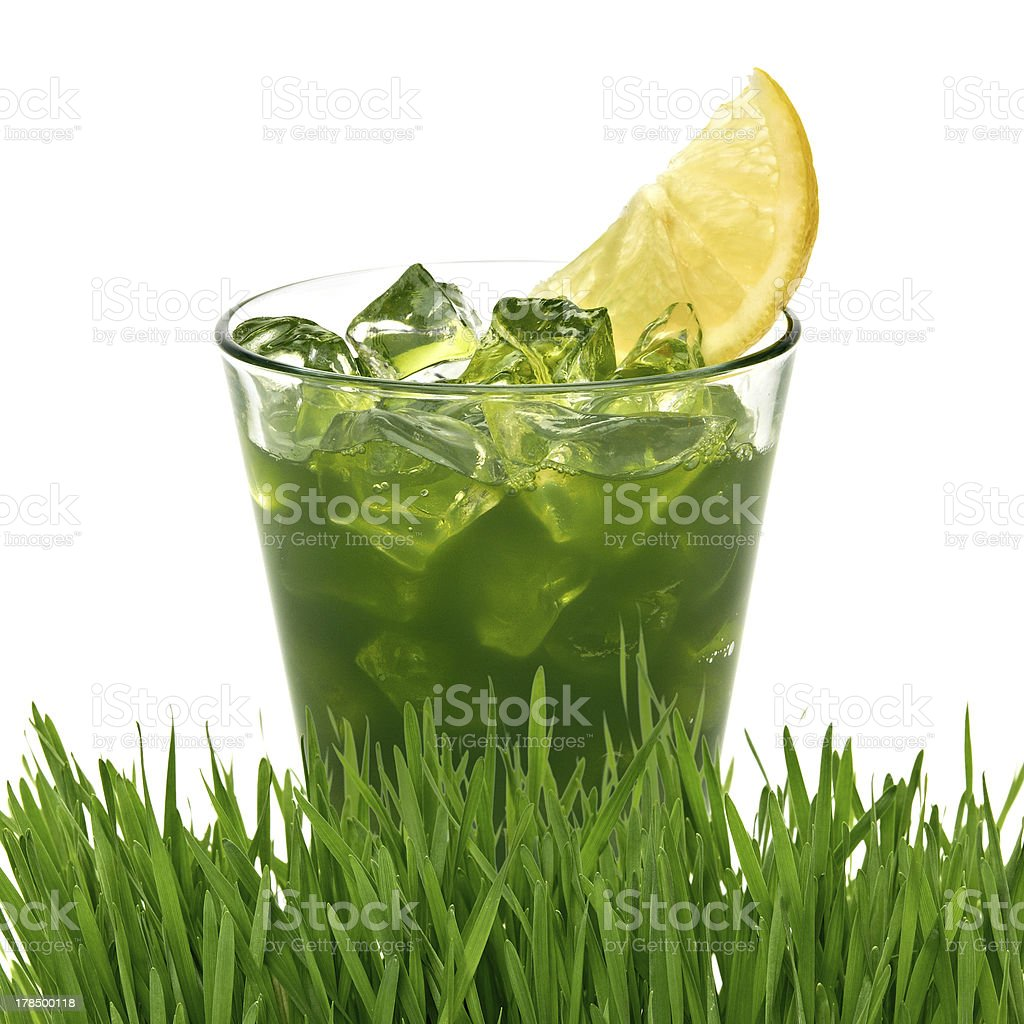 Wheat grass juice with ice and lemon stock photo