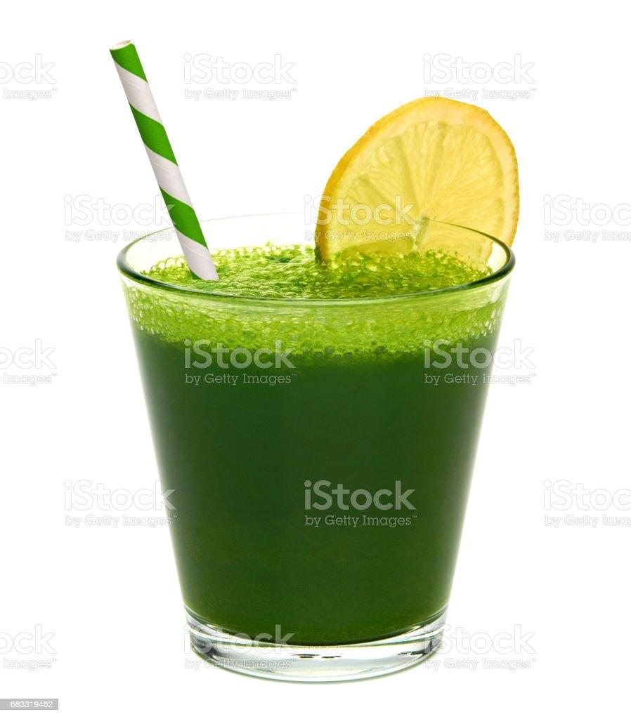 Wheat grass juice with lemon slice photo libre de droits