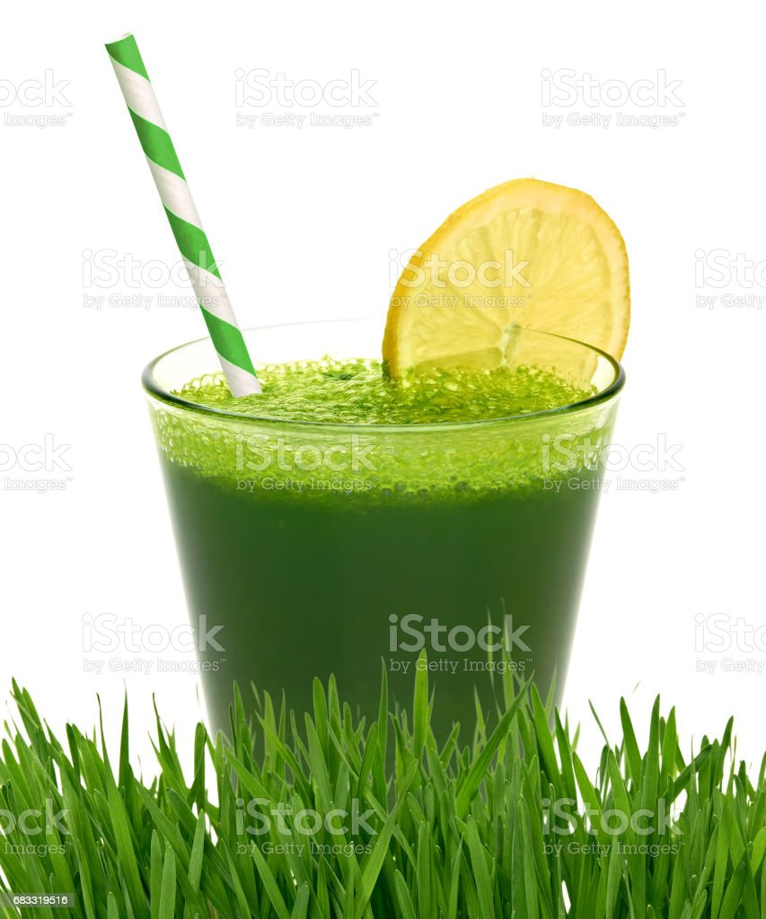 Wheat grass juice with lemon slice royalty-free stock photo