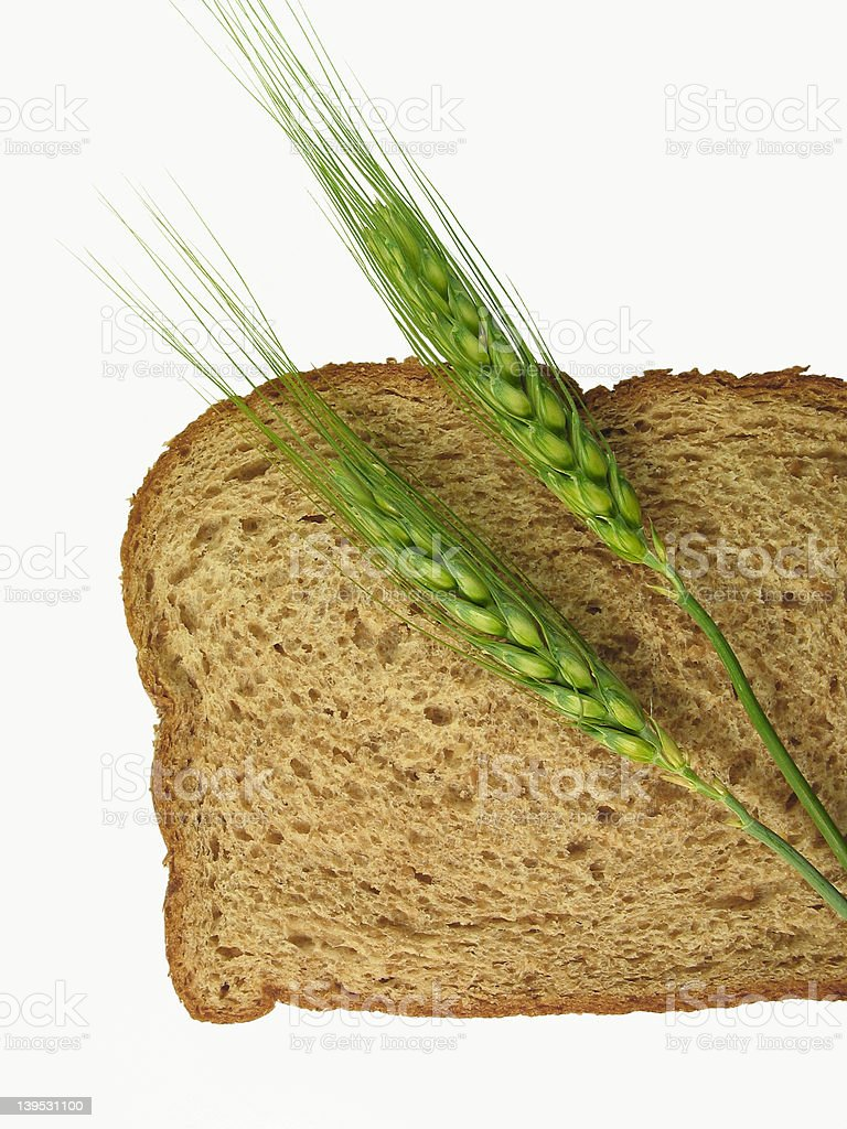 Wheat Spikes and Bread Slice royalty-free stock photo