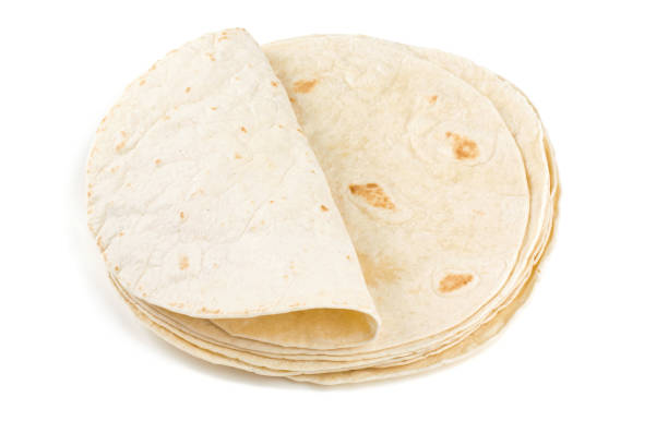 wheat tortillas isolated on white - tortilla stock photos and pictures