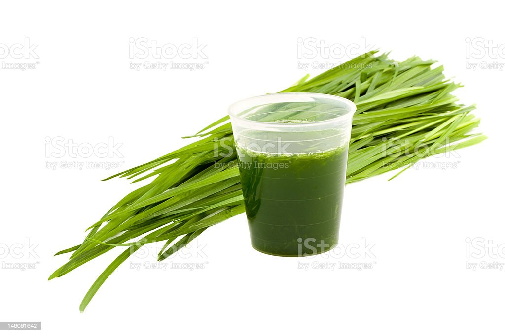 Wheatgrass drink isolated on white background stock photo